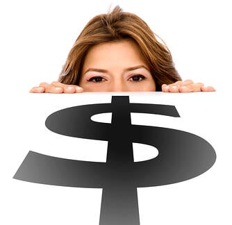 business woman looking at the money sign on the table - isolated