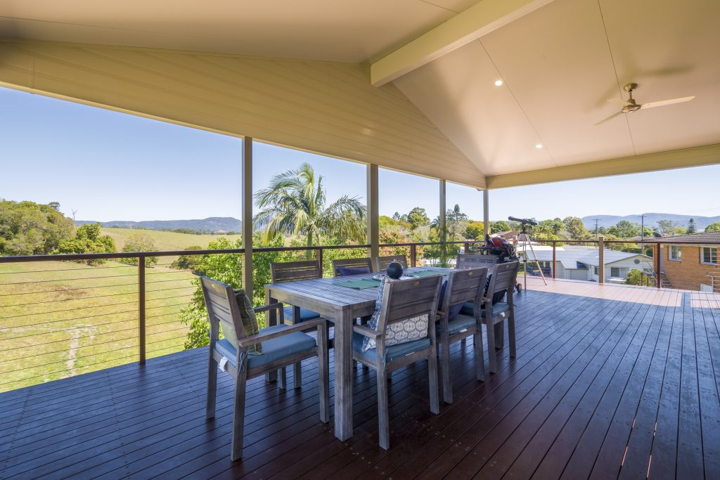 the view from a modular prefab home on a sloping site near qld